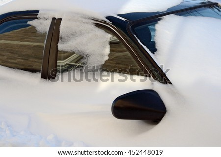 Car covered by snow after the snowstorm. - stock photo
