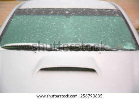 Car covered in ice and frozen from ice storm - stock photo