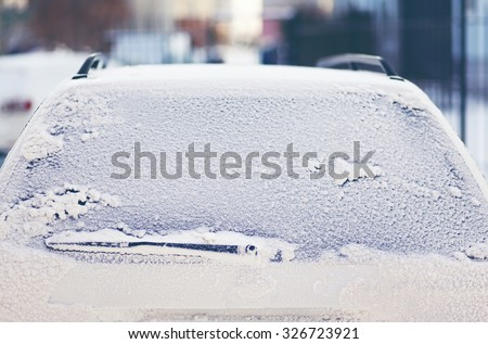 Car covered snow, frozen back window vehicle winter - stock photo