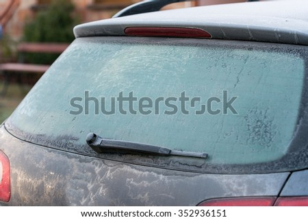 car covered with frost. Cold morning - stock photo