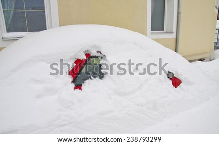 car covered with snow during winter - stock photo