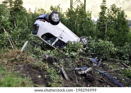 car crash bottom, turned upside-down after road collision - stock photo
