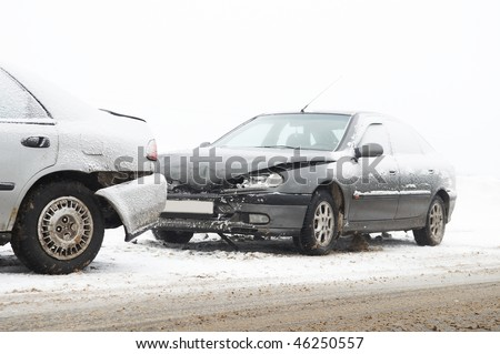 car crash ca accident at snow road in winter - stock photo