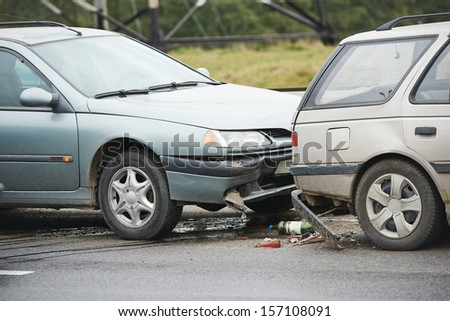 car crash collision accident on an city road highway - stock photo