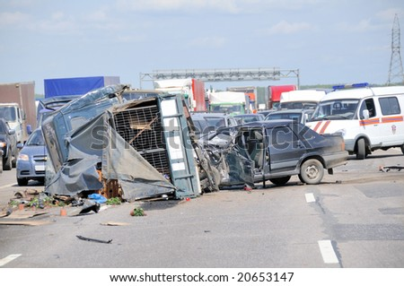 Car crash on major highway . Ambulance in background. - stock photo