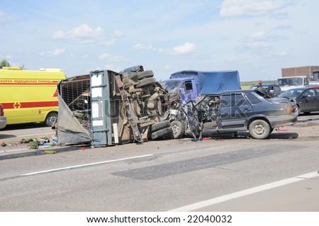 Car crash on major highway . Ambulance in background. - stock photo
