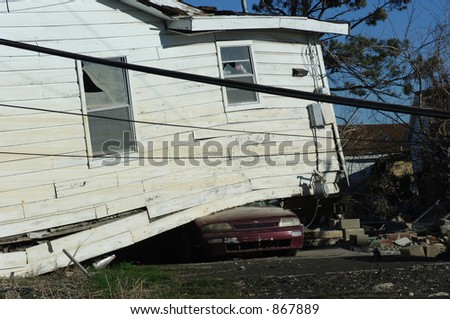 Car Crushed by houe - 9th Ward, New Orleans - stock photo