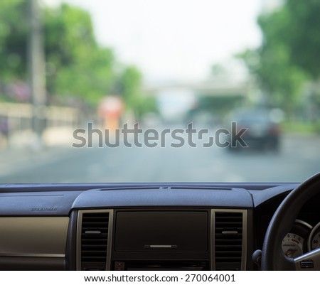 Car dash panel with blurred street background for your design - stock photo