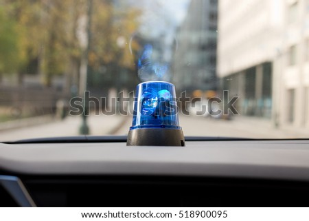 car dash with rotating emergency light