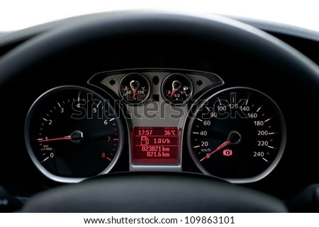 Car Dashboard. Close up image of illuminated car dashboard. - stock photo