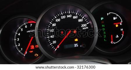 Car Dashboard closeup with glowing arrows - stock photo