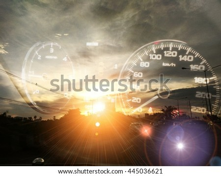 Car dashboard on the road at sunset - stock photo