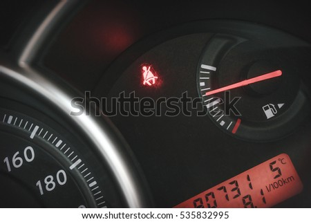 "Car Dashboard or Console panel with Illuminated sign ""belt is not fastened"". Car Safety concept. Close up"