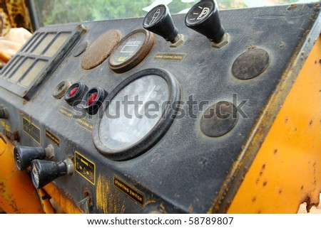Car dashboard scoop soil - stock photo