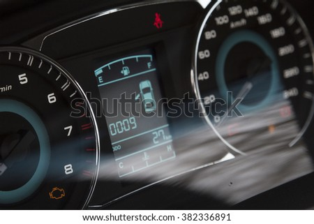 Car dashboard speedometer, information, tachometer - stock photo