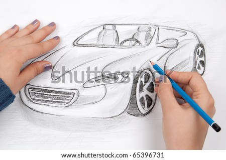 Car designer sketches concept car - stock photo