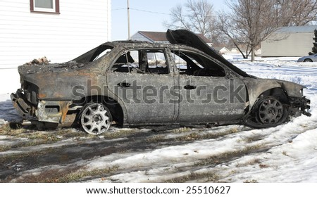 Car destroyed by fire.