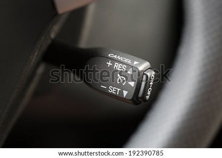Car detail, cruise control switch - stock photo