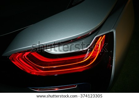 Car detail. New taillight by night. The rear lights of the car, in hybrid sports car developed by model 2016. Car's rear brake light. - stock photo