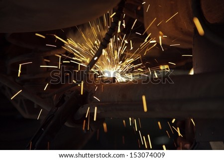 Car detail of welding , Welder at work  - stock photo