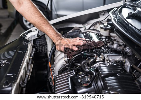 Car detailing series : Cleaning car engine - stock photo