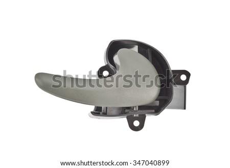 car door handle isolated. Car door interior arm rest with window control panel, door lock button, and mirror control - stock photo