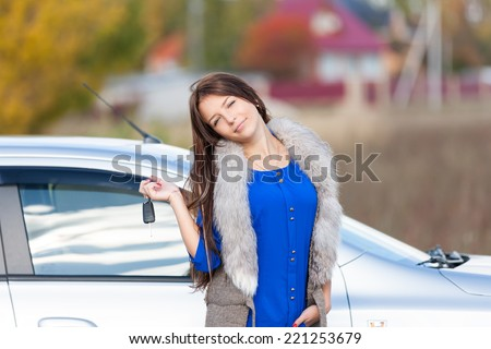 car driver woman showing new car keys - stock photo