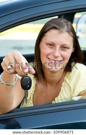 car driver woman smiling showing new car keys - stock photo