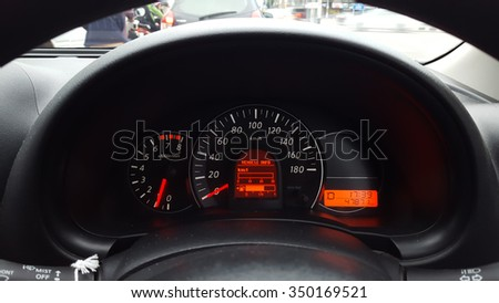 car driving at day,show instrument panel and traffic jam. - stock photo