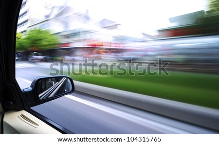 car driving fast in the city - stock photo