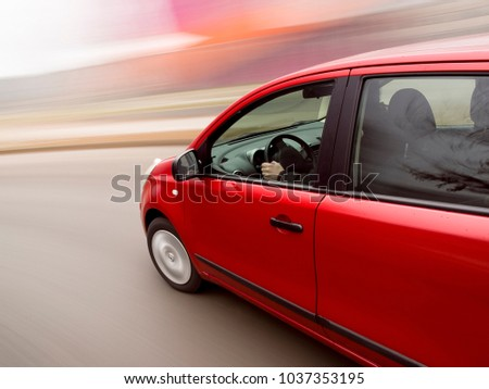 Car driving fast in the curve