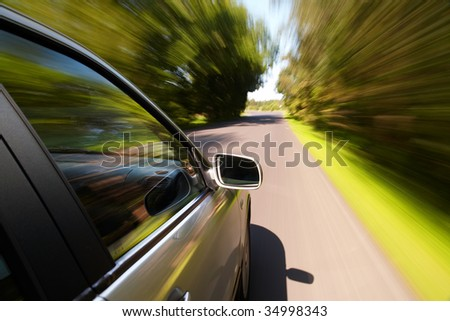 Car driving fast on a country road