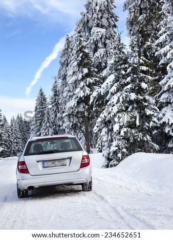 Car driving in winter landscape - stock photo