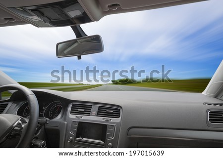 Car driving on an asphalt blurred road