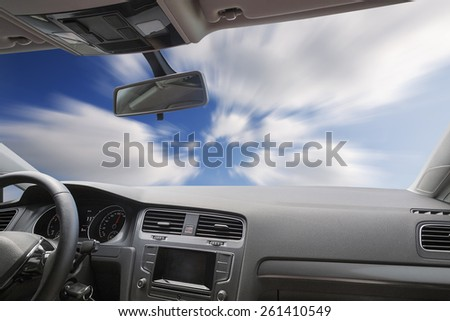 Car driving on an asphalt blurred road - stock photo