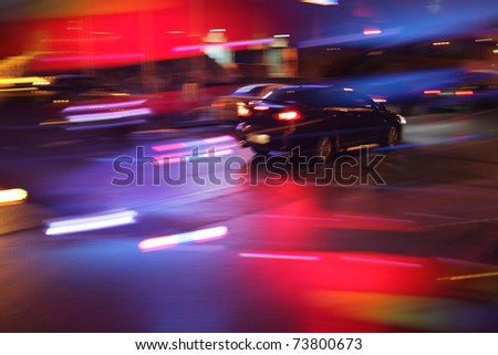 Car driving on night street. Long exposure, blurred motion. - stock photo