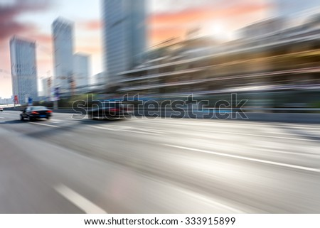 Car driving on road in Beijing, motion blur