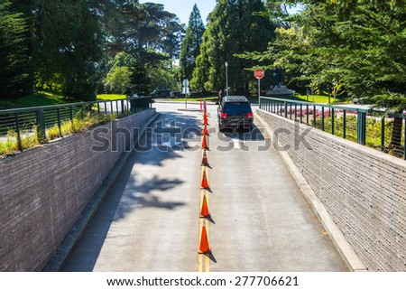 Car driving up from underground parking lot - stock photo