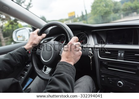 Car driving with both hands on the wheel - stock photo