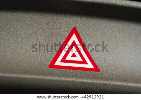 Car emergency attention light button in red triangle - stock photo