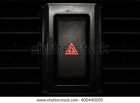 car emergency light button, man pressing red triangle car hazard warning button. - stock photo