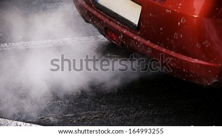 Car emissions - stock photo