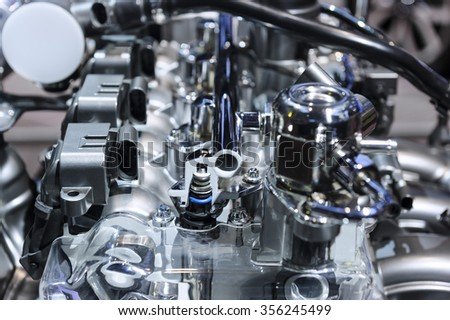 Car engine, concept of modern automobile motor with metal, chrome, plastic parts  - stock photo