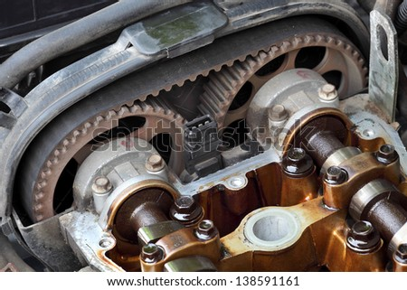 Car engine head two camshaft system, pulley, belt and injectors, selective focus - stock photo