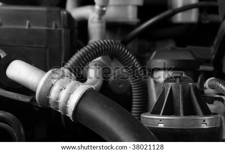 Car engine hose and parts diy maintenance concept theme in black and white - stock photo