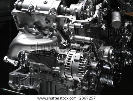 Car engine part - Close up image of an internal combustion engine. - stock photo
