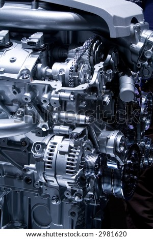 Car engine part - Close up image of an internal combustion engine. Metallic texture, not noise. - stock photo