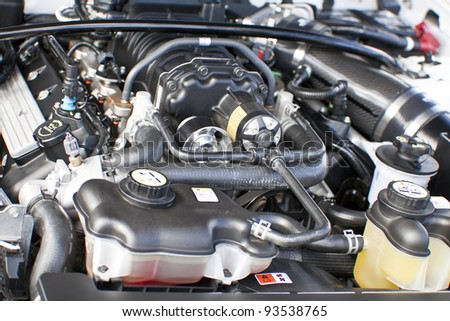 Car engine under the open hood - stock photo