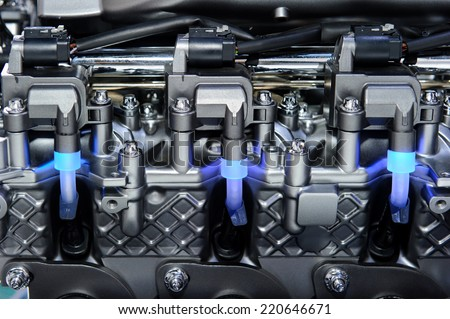 Car engine with fragment of metal and chrome parts of automobile motor - stock photo
