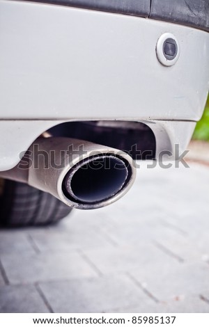 Car exhaust - stock photo